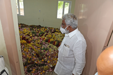 TTD chairman Y V Subba Reddy inspecting the dry flowers